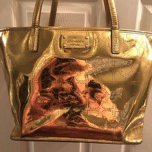 large gold Kate Spade purse